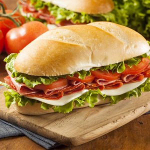 Ham, Swiss Cheese, Salami, Turkey, Tomatoes, Pickles, Lettuce with Special House Dressings